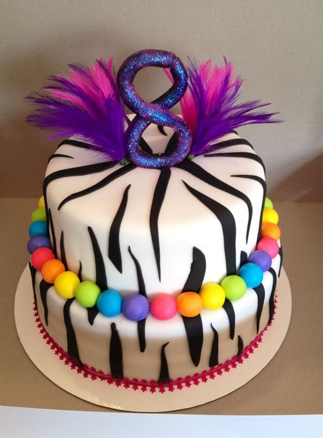 zebra cake for an 8 year old. Fondant covered with fondant decor, edible glitter on the 8 and some feathers sticking out