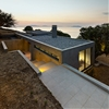 House in Kea is a concrete residence built around oak trees on a Greek isle