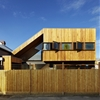 Triangular void connects a two-storey timber extension to a Melbourne bungalow
