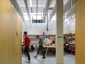 Hawkins\Brown uses wooden partitions to create temporary warehouse home for The Bartlett