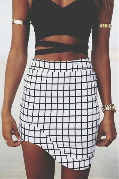 Plaid skirt on a tan and beautiful skin. Organic Sunless Tanner. Odorless,fast drying. Get it @MySkinsFriend.com