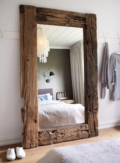 A mirror framed with reclaimed wood is an unexpected decorative piece with real rustic charm.