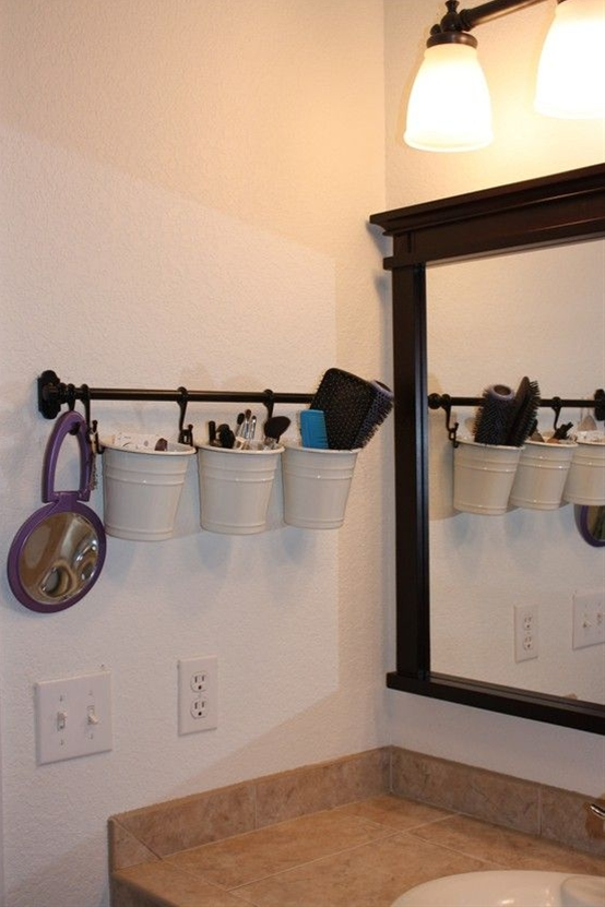 Makeup/etc storage. I love this idea! You can get cute different color pails from the dollar section at target!