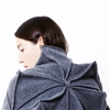 Wool pyramids form origami-inspired Bloom blanket