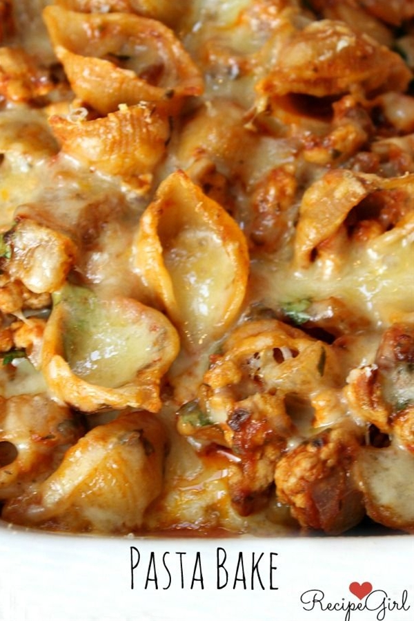 Ingredients: 1 tablespoon olive oil,  1 medium onion, chopped,  2 large garlic cloves, minced,  1/4 teaspoon red pepper flakes,  3/4 pound ground turkey (10% fat),  4 cups cooked whole wheat pasta shells (see *Tips below),  2 1/2 cups marinara sauce (bottled or homemade),  1/4 cup chopped fresh parsley,  1 1/2 cups shredded Monterey Jack cheese (divided),  1/4 cup grated fresh Parmesan cheese.