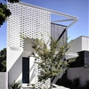 Perforated Brick Entrance Screen Defining Fairbairn Road House in Australia