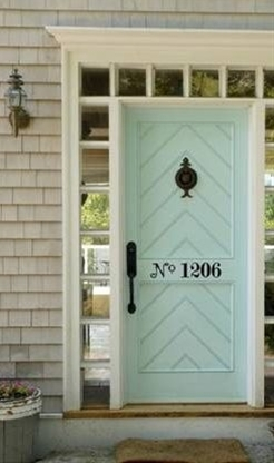 This reminds me of what HGTV's John Gidding always says on Curb Appeal - one of the easiest ways to transform your home on the exterior is to focus on your door (color & numbers).