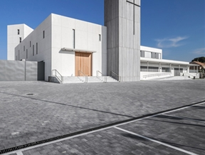 Hernández Arquitectos' minimal white monastery features a concrete-clad bell tower