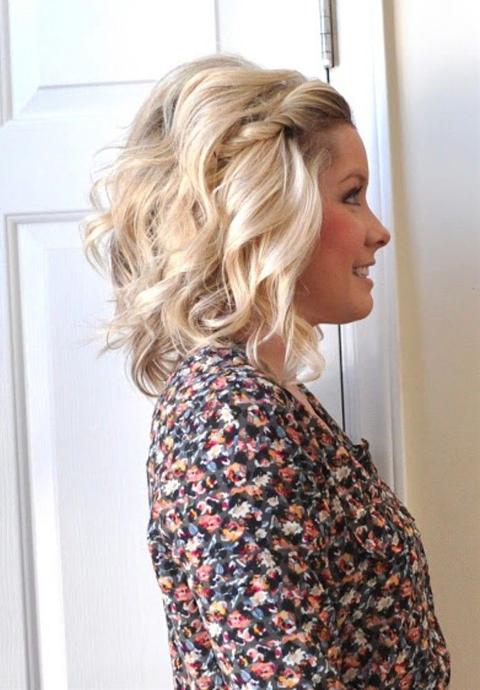Pulled back bangs are always a great way to style shorter hair, but twist them to add something extra. Combine the twist with a mixture of loose waves and beach texture