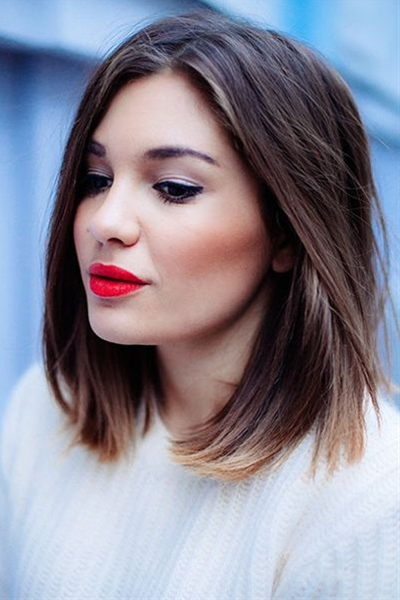 A shoulder-length blunt cut is versatile and easy to style.