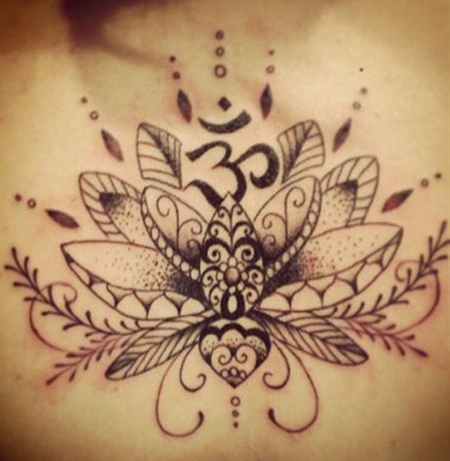 The lotus with its high symbolic value is juxtaposed with the symbol Aum in this creative tattoo. For those who are unaware, Aum symbolizes divine and complete peace. This aesthetic piece of art has much spiritual significance.