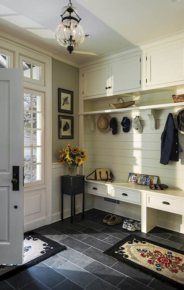 The mudroom features Benjamin Moore Carrington Beige for the walls and Benjamin Moore Navajo White for the trim.