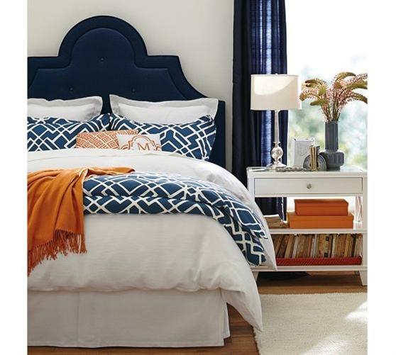 navy blue, orange, and white - love the navy headboard, orange throw, and orange boxes