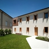Massimo Galeotti adds modern timber infill to the corner of an old Italian villa