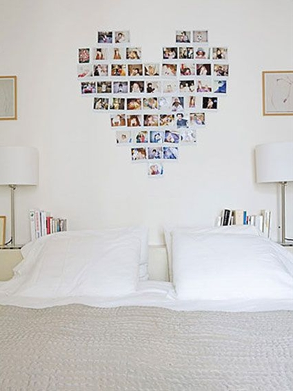 A heart (or other shape) made from Polaroid pictures form a very personal background in this bedroom.