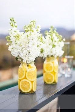 White Stock in mason jars filled with sliced lemons. The stock has a beautiful sweet smell that mixes well with the fragrant lemons - love it!