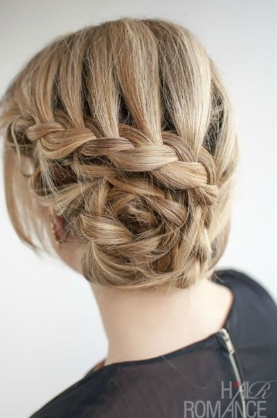 This hairstyle is made up of two curved lace braids. A lace braid is the same as a French braid, but you only add in hair from one side. For this style, I'm only adding in hair from the top side. The braids are then twisted around and pinned in place.