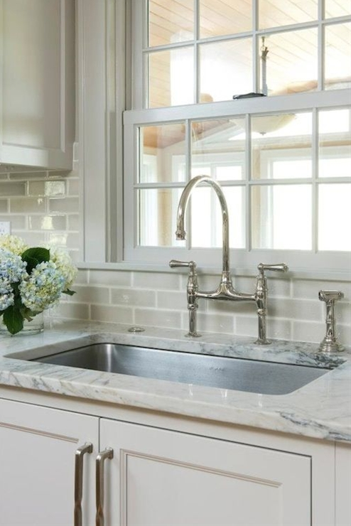 light gray kitchen cabinets, ivory supreme quartzite counters, stainless steel undermount sink, polished chrome faucet, polished chrome bridge faucet,nickel hardware