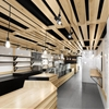 Au Pain Doré bakery by Naturehumaine features slatted wood ceiling