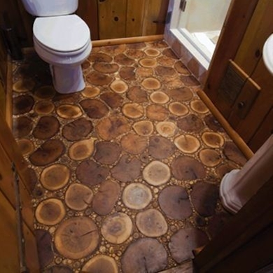 this bathroom floor comprises horizontal cuts of oak, birch, and maple, as well as tiny twigs and branches gathered from the client's property.