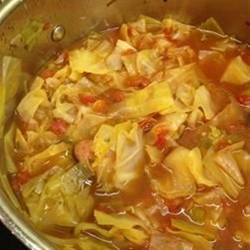 Ingredients: 5 carrots, chopped,  3 onions, chopped,  2 (16 ounce) cans whole peeled tomatoes, with liquid,  1 large head cabbage, chopped,  1 (1 ounce) envelope dry onion soup mix,  1 (15 ounce) can cut green beans, drained,  2 quarts tomato juice,  2 green bell peppers, diced,  10 stalks celery, chopped,  1 (14 ounce) can beef broth.
