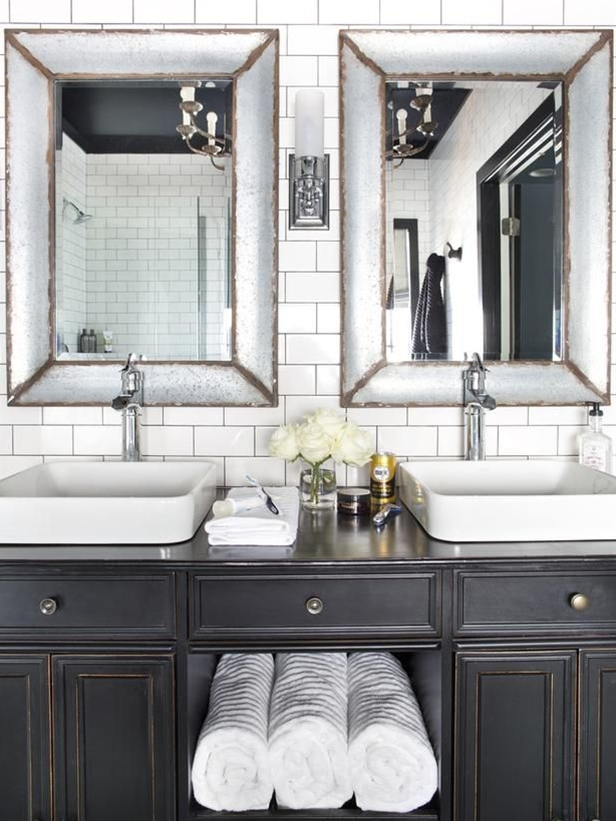 A bland and boring master bathroom is reborn as a bold, beautiful, black and white retreat.