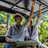 Street Photography at its best. Tourists in a Thai taxi. by...