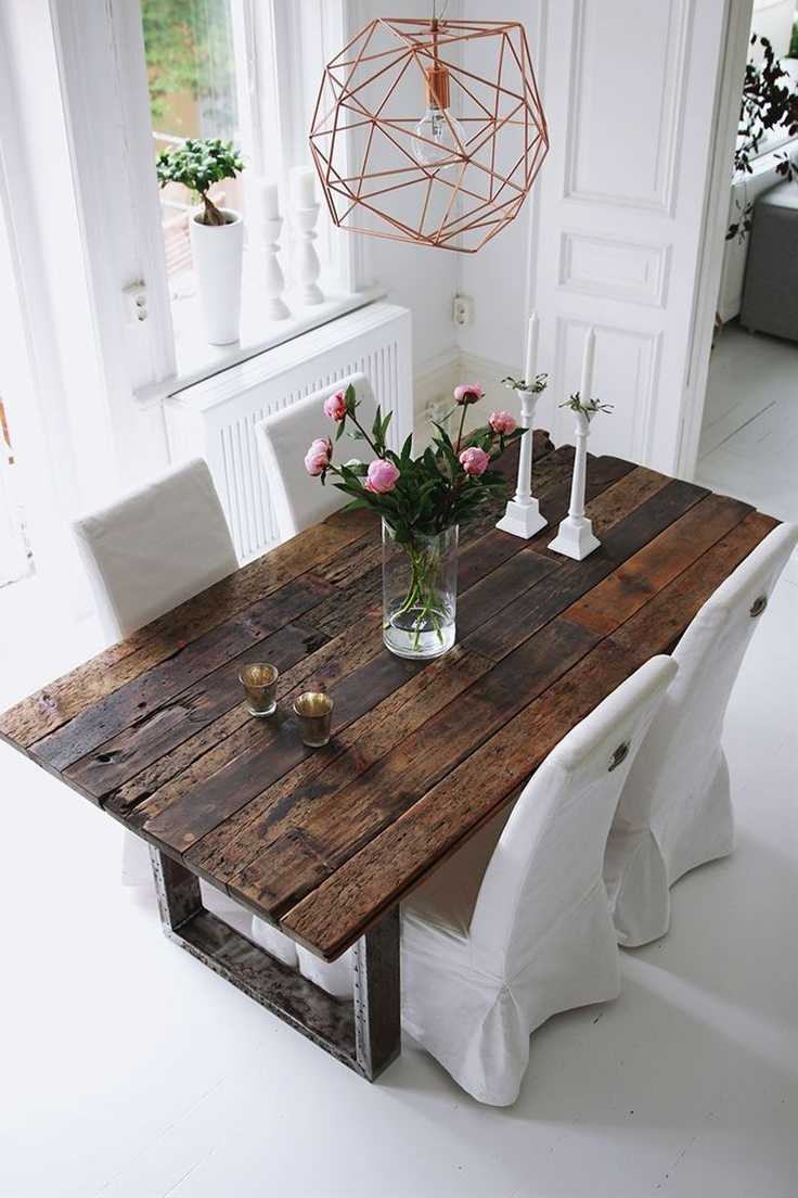 Love the rustic style, and that the table is partly built of wood from an old boat makes it even more charming