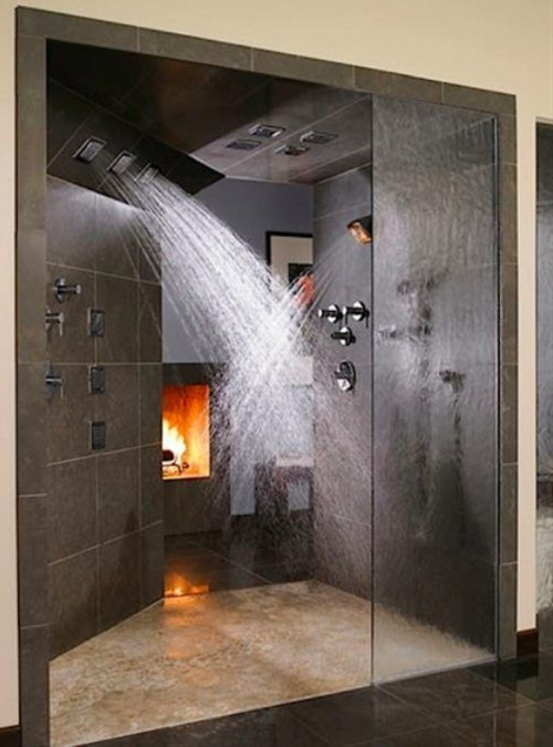 Turn your bathroom into a luxurious spa with this splendid shower and burning fireplace.