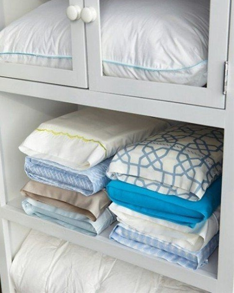 Don't let your matching sheets get lost in the linen closet. Use this simple trick: Tuck the sheet set inside one of its pillowcases, and then stack according to size (twin, full, queen, king) or by the room you use the sheets in (master bedroom, guest room.)