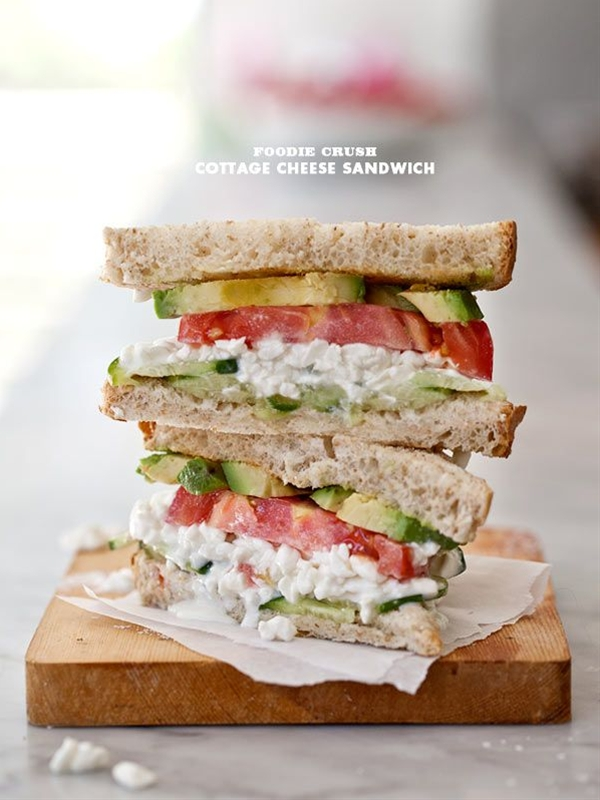 Ingredients: 2 slices wheat bread,  1 tablespoon butter,  1/3 cup cottage cheese,  1 slice tomato,  1/2 avocado, sliced,  4 slices cucumber,  salt and pepper.