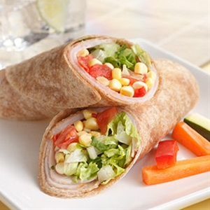 INGREDIENTS: 1cup(s) corn kernels fresh or frozen,  1/2 cup(s) chopped fresh tomato,  1/4 cup(s) chopped soft sun-dried tomatoes,  2 tablespoon(s) canola oil,  1 tablespoon(s) red-wine vinegar or cider vinegar,  8 (about 8 ounces) thin slices low-sodium deli turkey,  4 whole-wheat tortillas,  2 cup(s) chopped romaine lettuce.