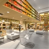 Colour-coded books produce a rainbow-like display in a Rio bookshop by Studio Arthur Casas