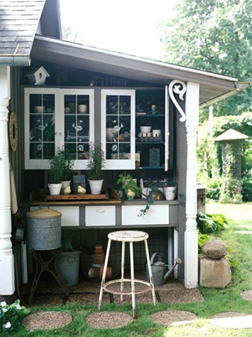 A potting area that would double as a getaway for me!!  Made from salvaged materials and great imagination.