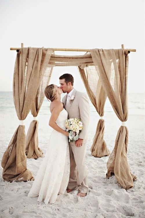 For a totally gorgeous, pin-worthy beach wedding, try these 5 tips:  1- Pick a dress that suits your venue. For the beach, something easy, breezy and flowy is better than a Cinderella ballgown better suited for a ballroom. 2- Go easy on the hair. If you still want a more formal dress, ditch the formal updo and embrace some natural, loose waves. 3- Choose more casual attire for your bridal party; think shorter dresses for the ladies and consider going barefoot! 4- Don't make your Groomsmen wear stuffy tuxedos; shorts and button ups, linen pants and cream-colored suits look quite dapper, too. 5- Incorporate nature into your decor! Seashells and sea-colored accessories all make beautiful beach wedding decor.