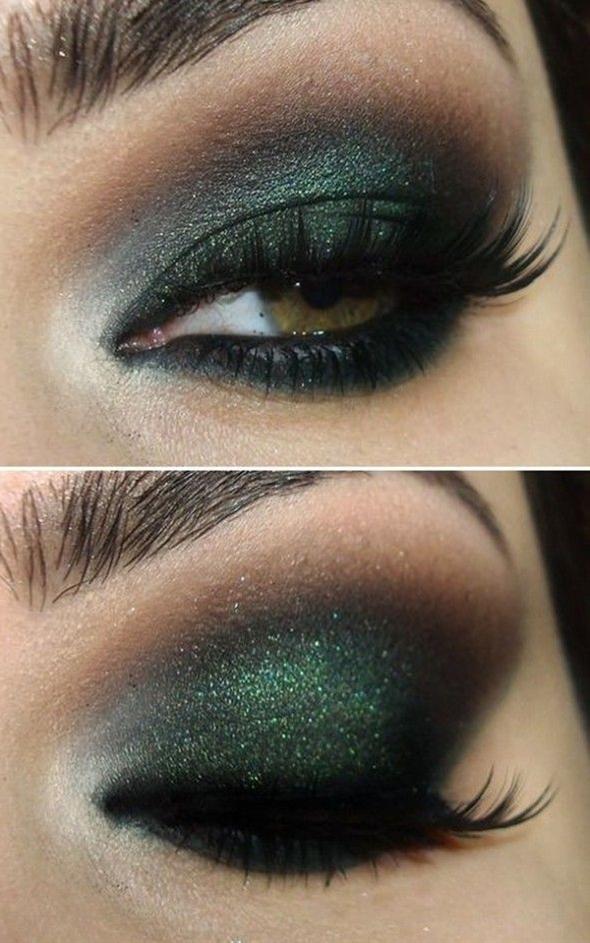 Dark green and black eye makeup w/ a bit of sparklies.