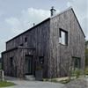 Mjölk Architekti's Carbon house features a burnt wood exterior