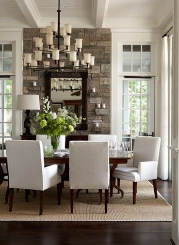 I like the beams in the ceiling, the transom windows above the doors/windows and use of white.  Too pottery barn tho.  I like the natural stone in the room, too.