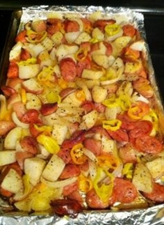 1. spray a large baking pan w/ nonstick spray . 2. slice sausages into thin rounds, about 1/5″ thick. 