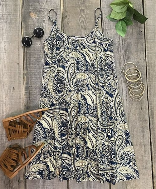 Want to look good, but it's just too hot outside? We've got the perfect dress for you. Whether you're vacationing or cozy at home, this Get Loose Paisley Slip Dress is a go-to choice.
