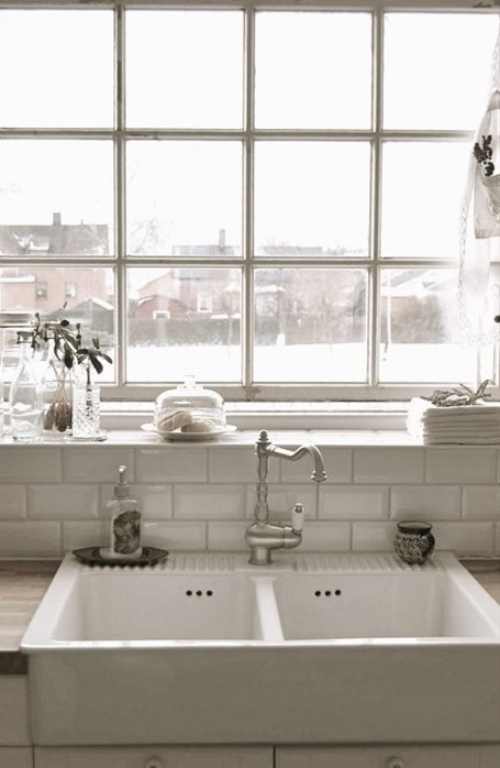 great combo... farm sink, subway tile and industrial window. White on white or black on naturals, either way its a success.