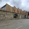Serrated timber extension by 3+1 Architekti transforms stone barn into woodwork facility