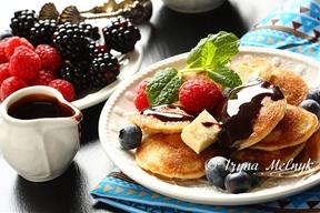 Dutch mini pancakes called poffertjes by Iryna  Melnyk