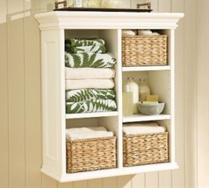 Guest bathroom storage idea (above toilet). Wall cabinets are highly recommended for small bathrooms. Unlike floor storage units that occupy a lot of space, these wall cabinets won't make the space any smaller than it already is.