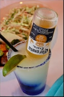 Corona-Ritas - In a pitcher, combine equal parts (use the limeade can to measure): Frozen limeade concentrate, water, Sprite, tequila, and add one Corona.  Stir, serve, and be careful, 'cause these guys go down waaaay too easy!