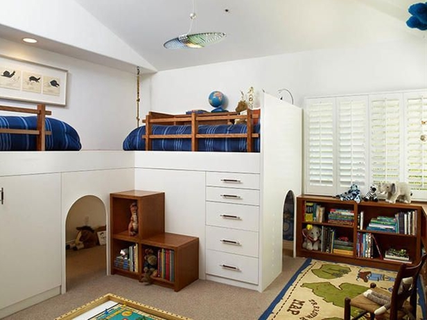 Designer Erica Islas creates a play cave with contemporary white lacquer beds, while still providing ample storage with drawers and useful stair cubbies.