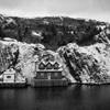 Fishing houses in a small village in a bay of a big cityquidi...