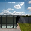 """SATA's medical centre has mirrored """"cloaking"""" roof that reflects the sky"""