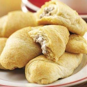 Ingredients:  1 pound ground beef,  1 can (4 ounces) chopped green chilies,  1 package (8 ounces) cream cheese, cubed,  1/4 teaspoon ground cumin,  1/4 teaspoon chili powder,  3 tubes (8 ounces each) refrigerated crescent rolls.