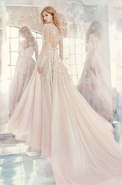 Beaded and embroidered bodice with illusion bateau neckline and V-neck front, full intricate back, tulle skirt with cathedral train. Hayley Paige Spring 2016 Wedding Dress Collection